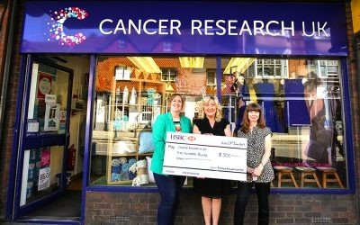 Platipus  present cheque to Cancer Research UK