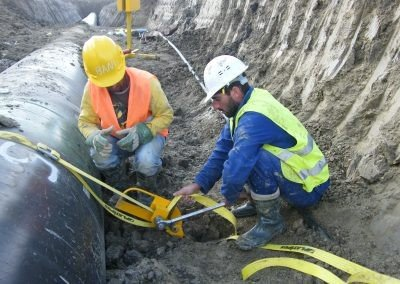 Webbing strap being tensioned for TAP Pipeline in Albania