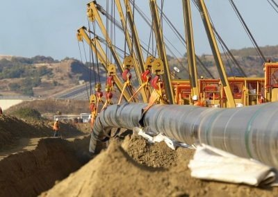 TAP pipeline being lowered into trenches, Northern Greece
