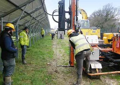 Workers loadlocking a Platius anchor using heavy machinery at the Crossways solar park in Dorset