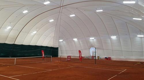 Inside a fully anchored infalatable dome ready for use as tennis courts