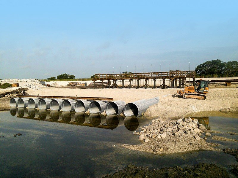 WCA3-Decomp-USACE-Miami-FL - Row of pipelines being installed with ground anchors