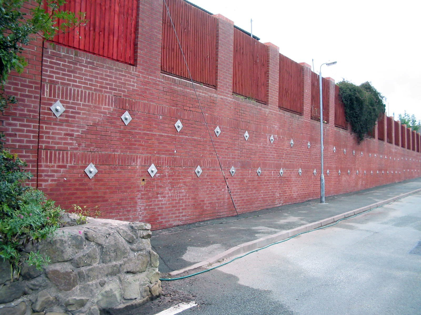 white lion close- ground anchors installed into wall