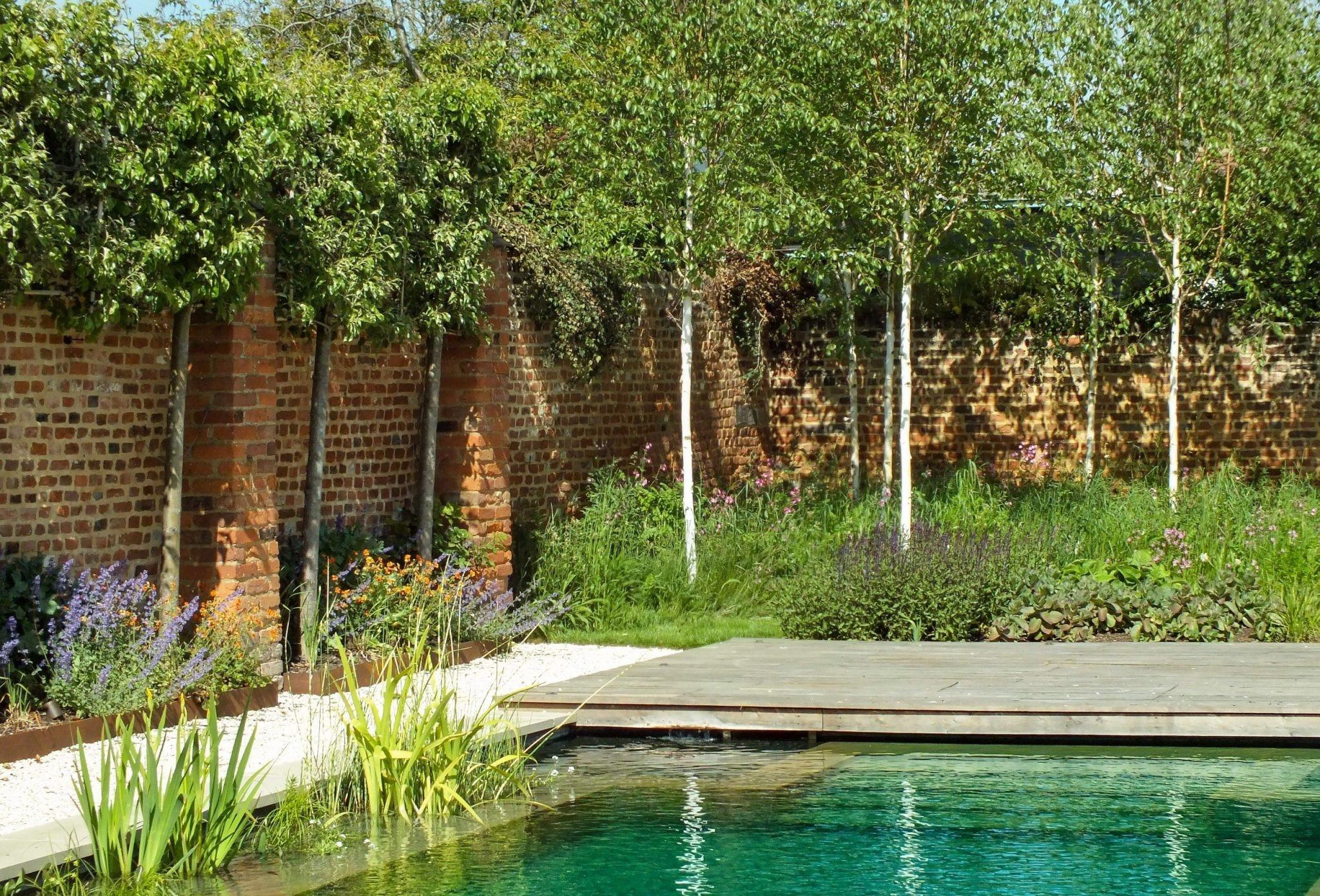 Walled garden next to water feature